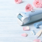Epilator on blue background