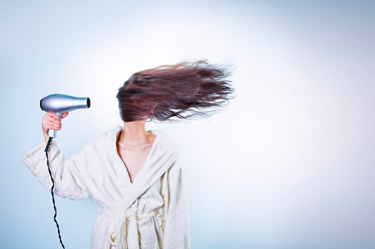 Woman blowing hair