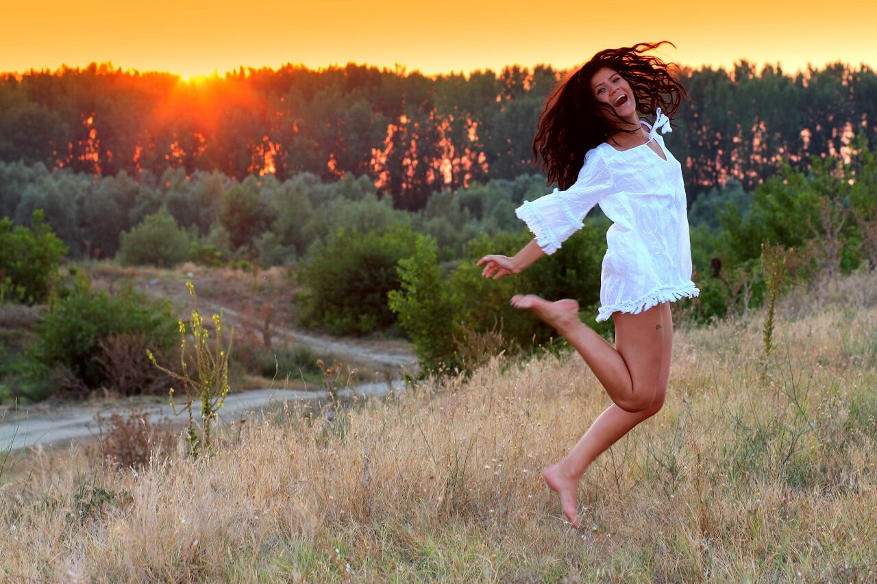 girl jumping in sunset
