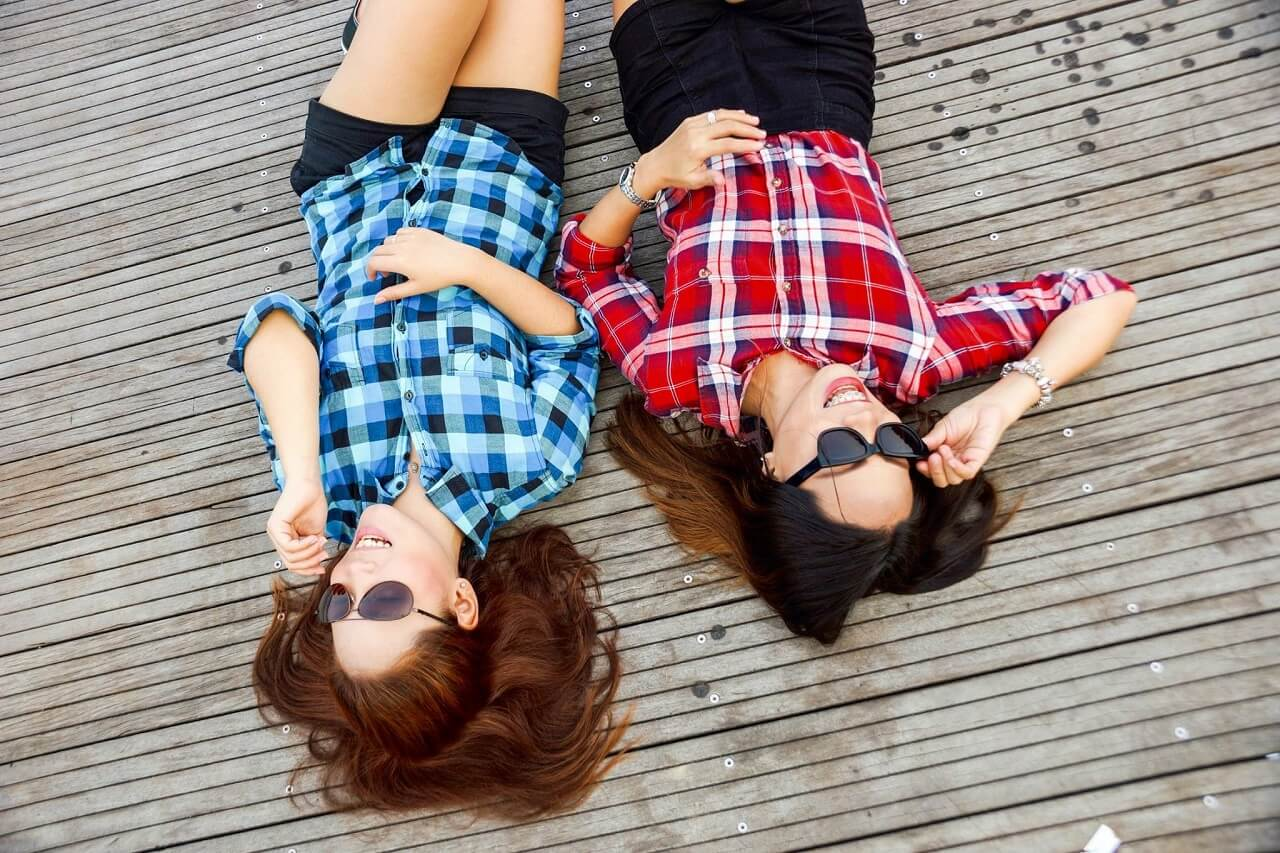 girls laying on the ground