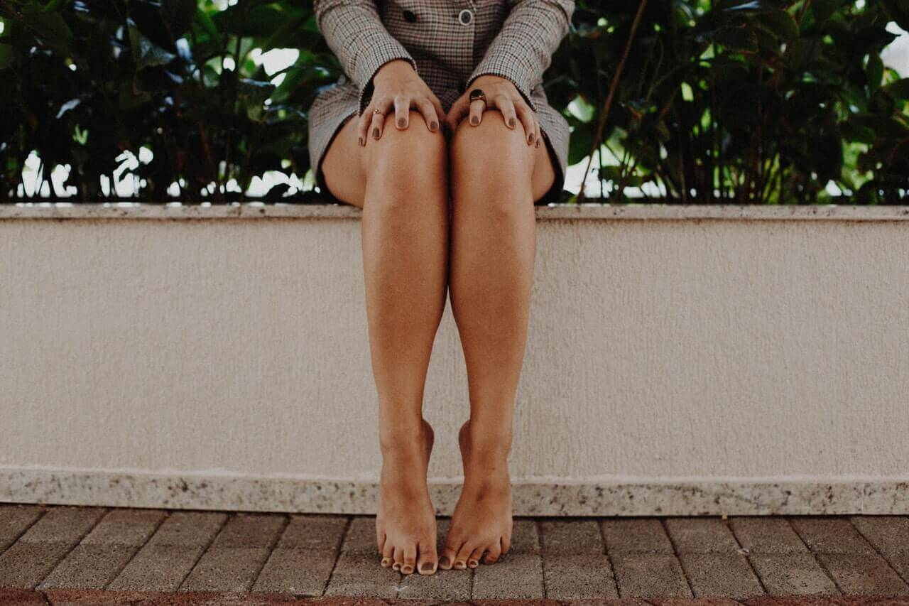 Woman sitting with smooth legs