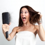 Women with Hair Loss and a Brush