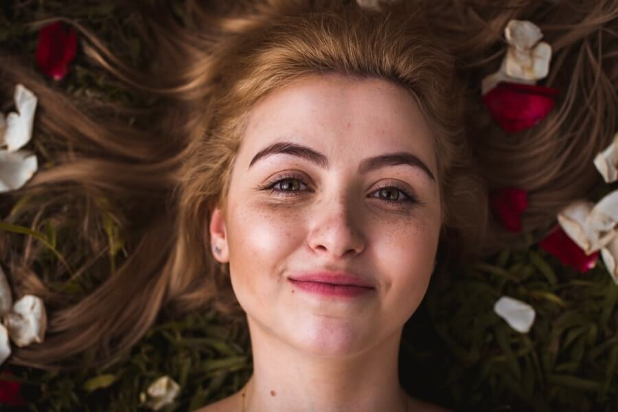Girl with rose petals in hairs