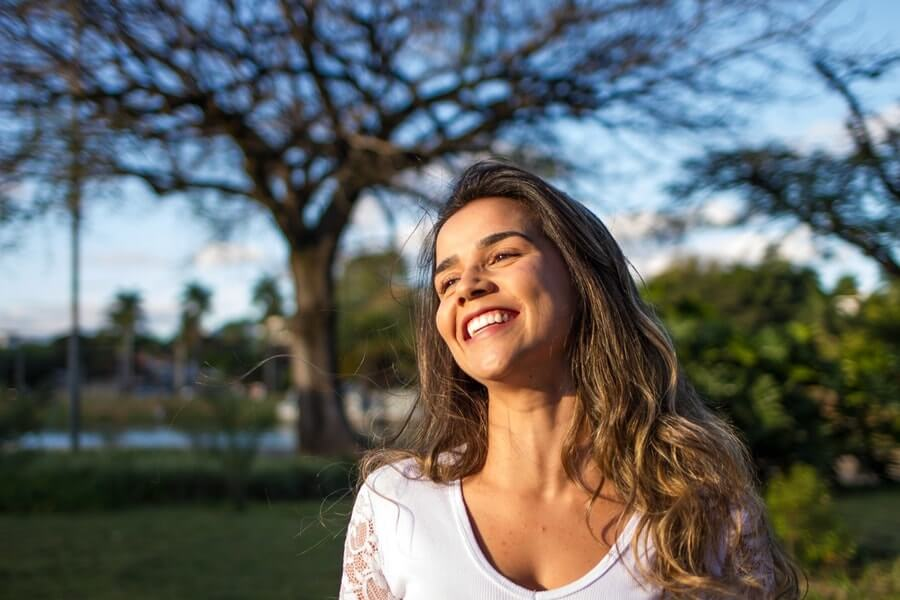 Woman smiling with the sun shining