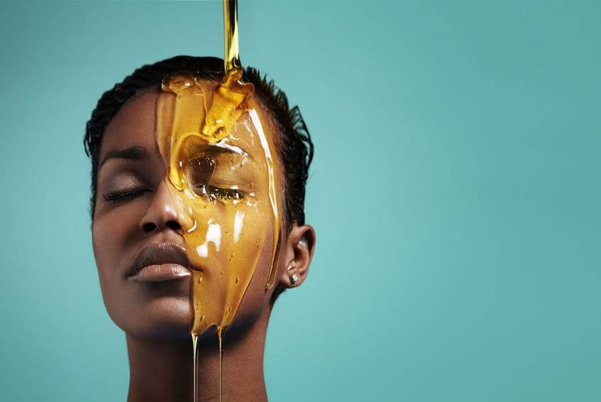Woman with honey on face